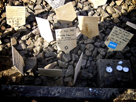 "Small sign written by Noah Botman placed on the rail track between Auschwitz and Birkenau ""For the 1900 of Rhodes Island and the 151 of them who survived History's Evil"" (March of the Living, Poland, April 2013)"