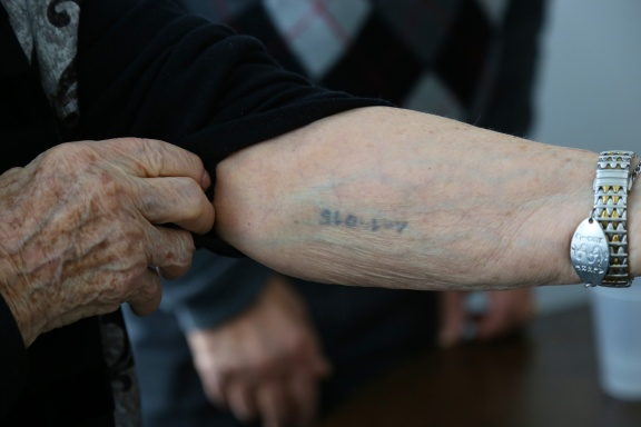 "Nancy Kleinberg, A-14015. ""I also got a tattoo. Mengele sat there. The girl (who tattooed me) was so rough. It was so painful. She slapped me in the face."" (Michel Botman Photography, Toronto, February 2013)"