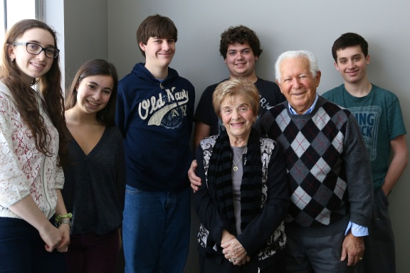 "Nancy and Howard Kleinberg with Jewish teenagers about to embark on ""The March of the Living"" (Michel Botman Photography, Toronto, February 2013)"