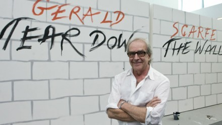 Gerald Scarfe before a representation of the Israeli Security Wall (Google Images)