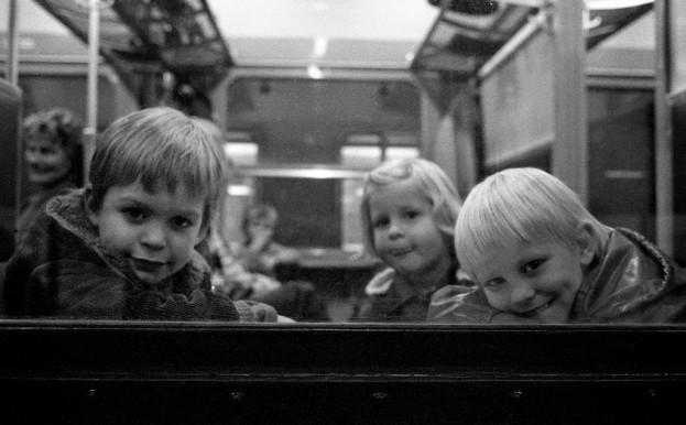 Children on the train to Brussels. Belgium, circa 1980. © Michel Botman Photography.