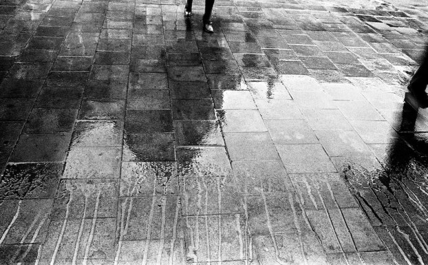 Train station in the rain. Brussels, circa 1980. © Michel Botman Photography.